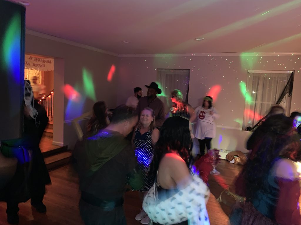 Happy people dancing at a party