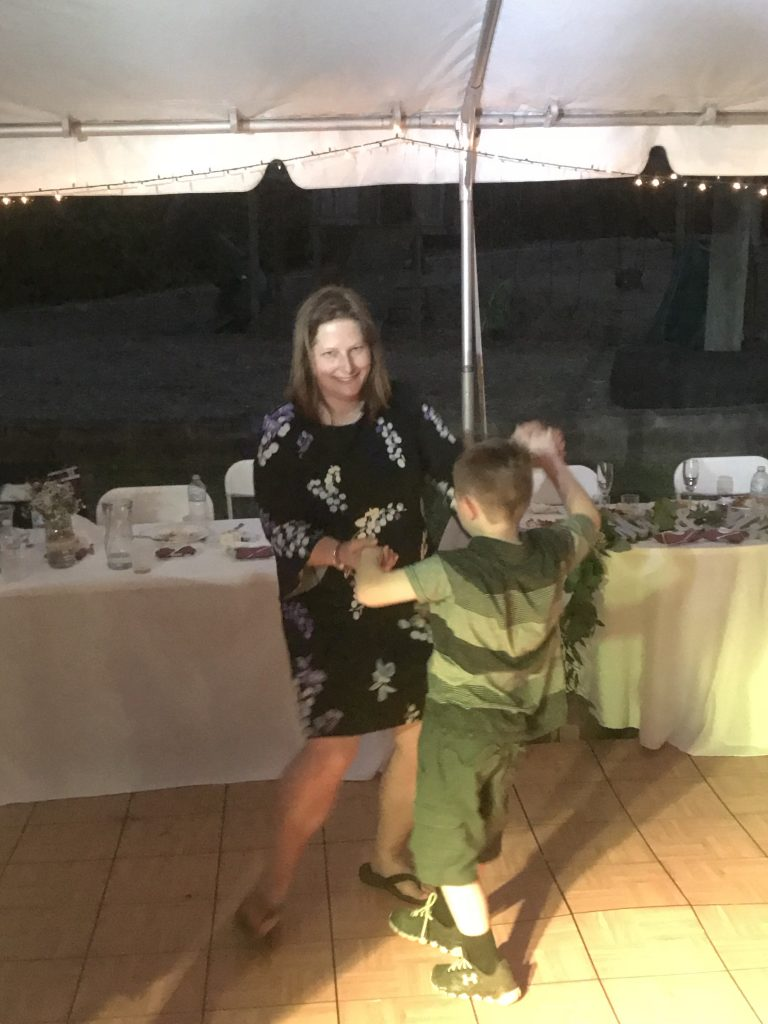 Mom and son dancing at a wedding reception