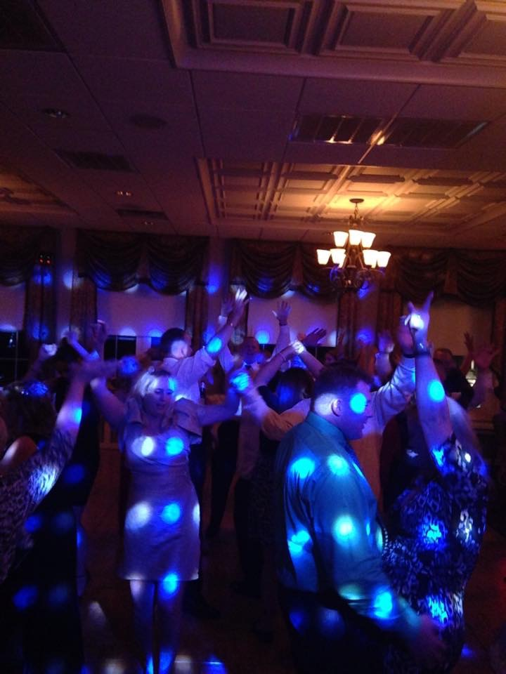 Happy people dancing at a wedding reception