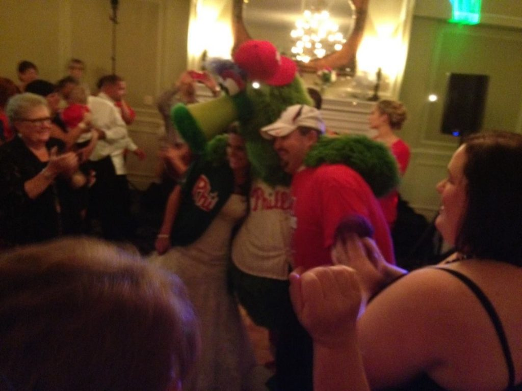 Bride and groom with the Philly Phanatic